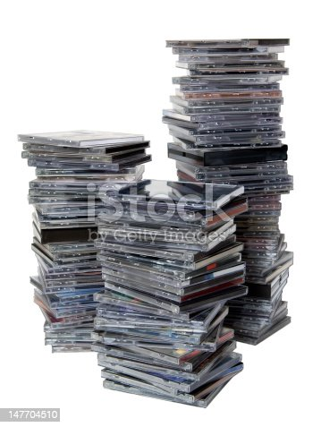 3 stacks of CDs on white background, there are approximately 100 cds.