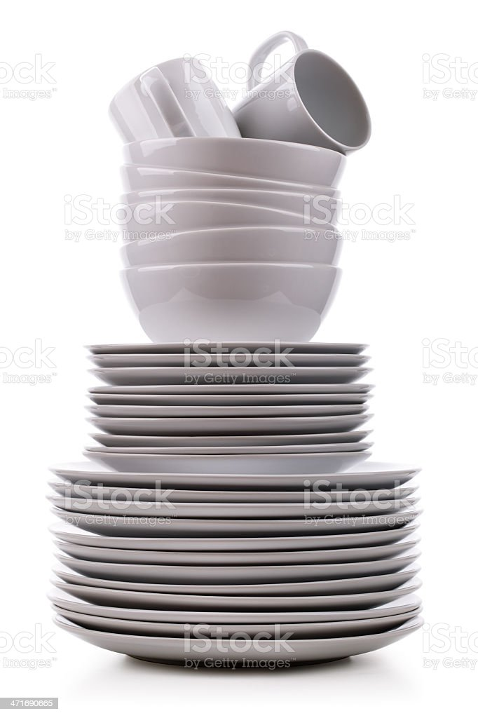 Stack of clean dishes on a white background stock photo