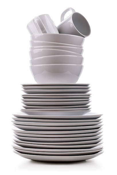 Stack of clean dishes on a white background foto