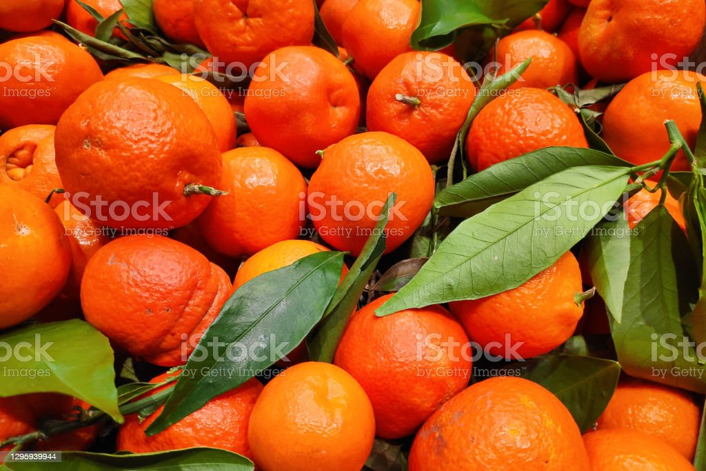 Stack of clementines on a market stall Close-up on a stack of clementines on a market stall. Agriculture Stock Photo