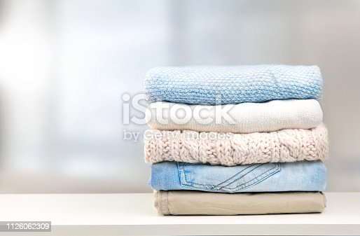 istock Stack of clothes empty copy space. 1126062309