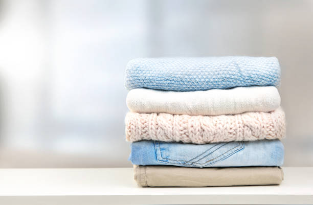 Stack of clothes empty copy space. Stack of clothes on  table empty space background. clothing stock pictures, royalty-free photos & images