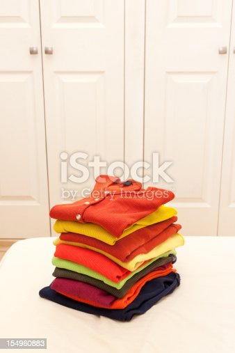 1164401397 istock photo Stack of clothing 154960883