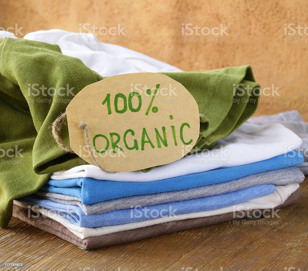 stack of clothing with organic label stock photo