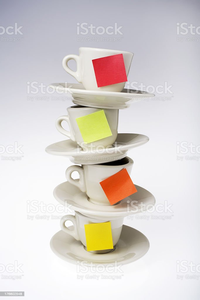 Stack of coffee cups with post-it notes stock photo