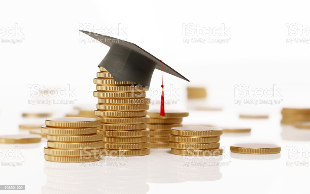 Stack Of Coins And A Black Mortarboard On White Background - Education And Savings Concept Metallic coins with a black mortarboard forming a financial graph over white background. Savings concept. Horizontal composition with selective focus and copy space. Advice Stock Photo