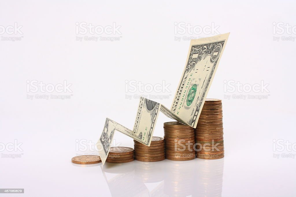 Stack of coins and a dollar bill representing wealth stock photo