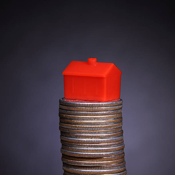 stack of coins and home stock photo