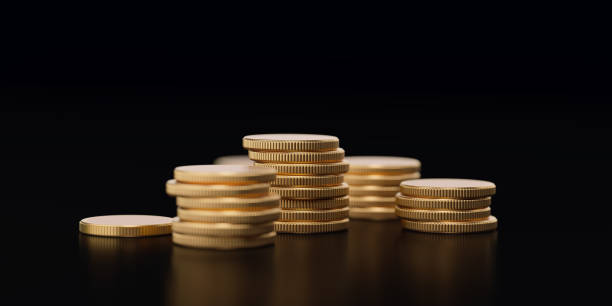 stack of coins forming a financial graph on black background - prosperity concept - money black background stock photos and pictures