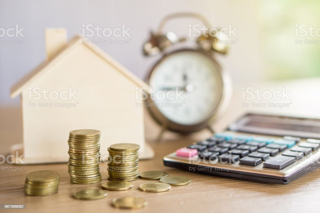 Stack Of Coins Planing To Buy Or Sell Home Concept Stock