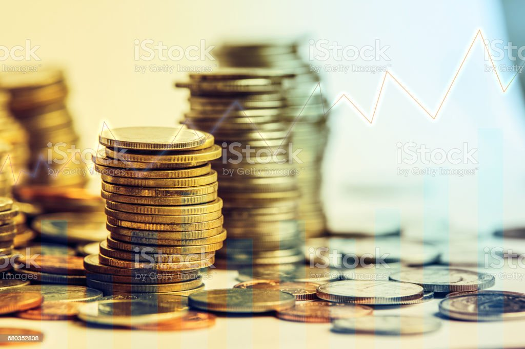 Stack of coins stock financial indices on currency exchange. Financial stock market in accounting market economy analysis. Digital stock exchange trade cost background. Economy financial cost concept; royalty-free stock photo