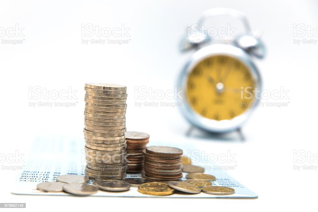 Stack of coins with vintage clock on white background for mocup display planning Money Financial and business Accounting Concept royalty-free stock photo