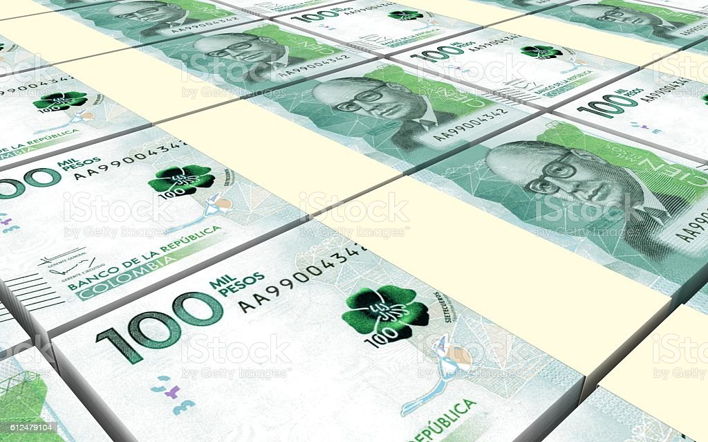 Stack of Colombian pesos bills stacks background. stock photo