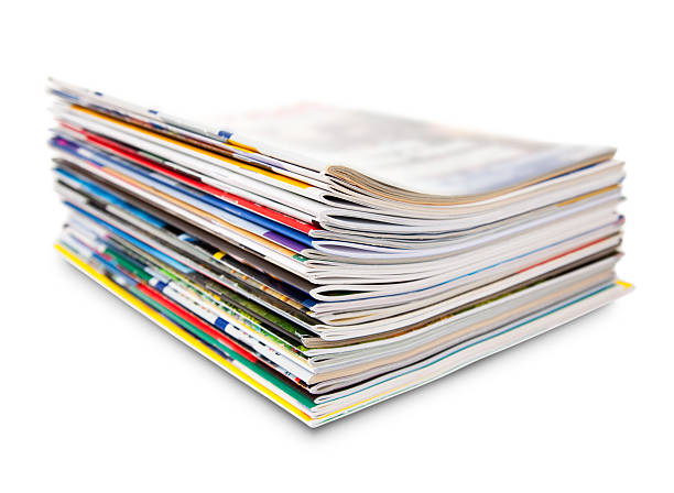 stack of color magazine - magazine stock photos and pictures
