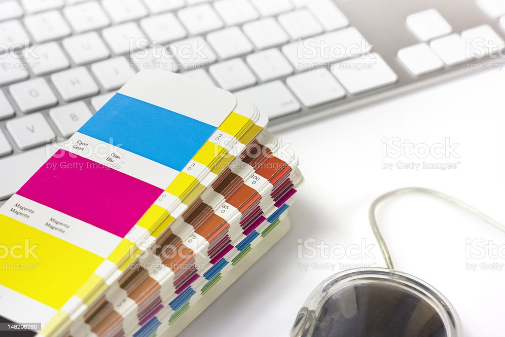 A stack of color swatches next to a keyboard royalty-free stock photo