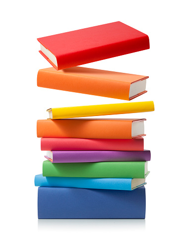Stack of colored books on white background.