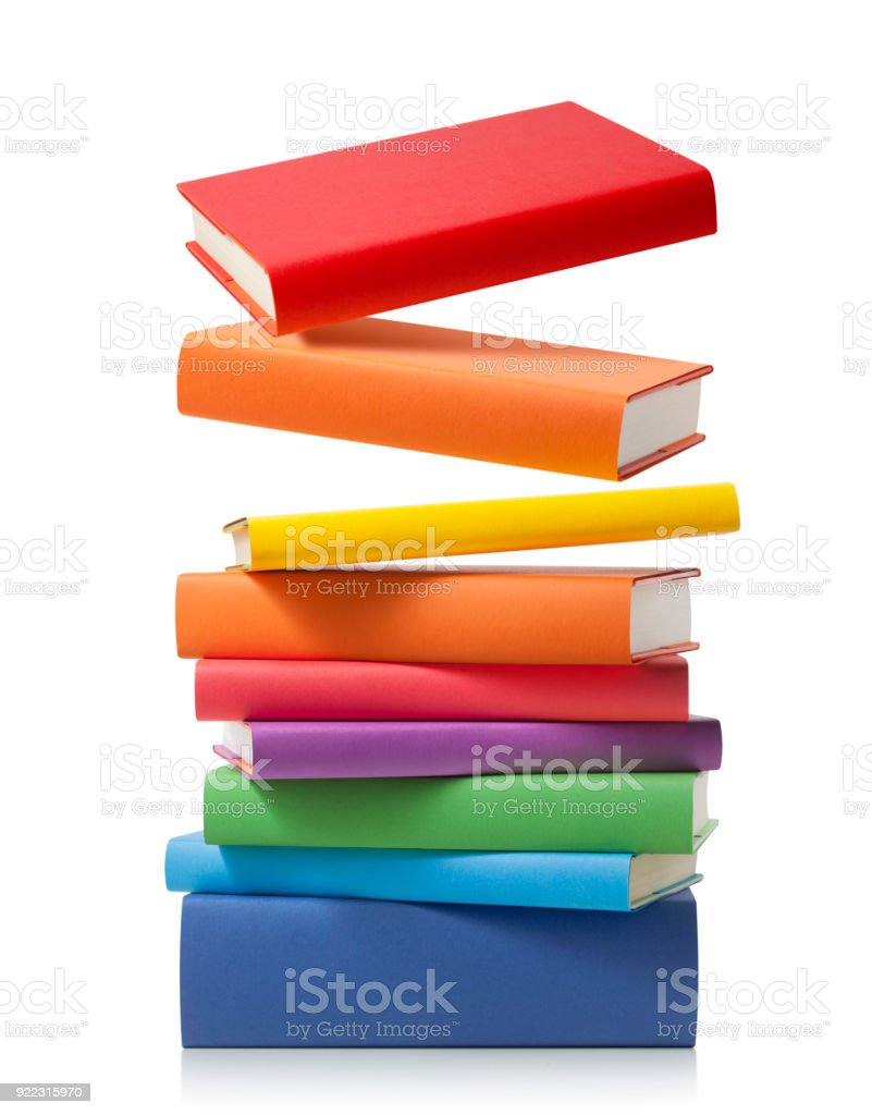 Stack of colored books on white background stock photo
