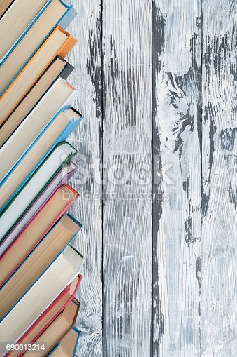 696860774 istock photo Stack of colorful books. Education background. Back to school. Book, hardback colorful books on wooden table. Education business concept. Copy space for text 690013214