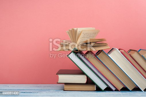 690358116 istock photo Stack of colorful books. Education background. Back to school. Book, hardback colorful books on wooden table. Education business concept. Copy space for text 690051400