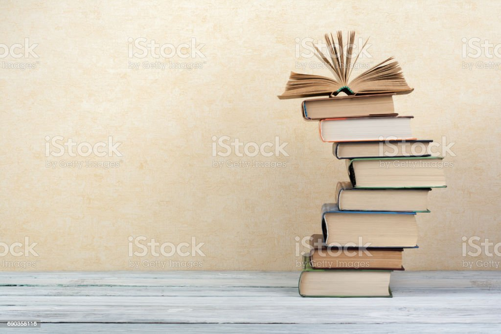 Stack of colorful books. Education background. Back to school. Book, hardback colorful books on wooden table. Education business concept. Copy space for text Stack of colorful books. Education background. Back to school. Book, hardback colorful books on wooden table. Education business concept. Copy space for text Abstract Stock Photo