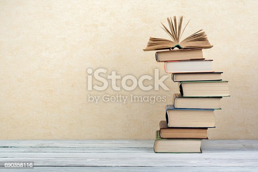 690358116 istock photo Stack of colorful books. Education background. Back to school. Book, hardback colorful books on wooden table. Education business concept. Copy space for text 690358116