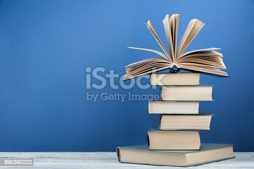 istock Stack of colorful books. Education background. Back to school. Book, hardback colorful books on wooden table. Education business concept. Copy space for text 690360222