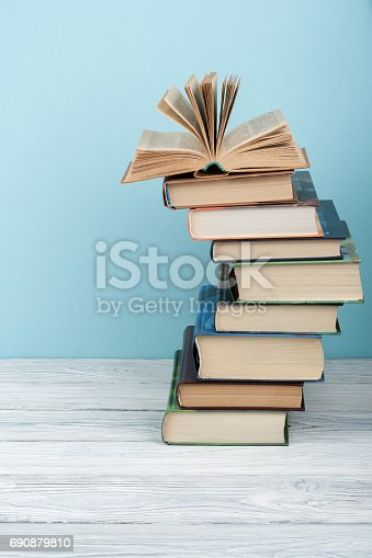 690358116 istock photo Stack of colorful books. Education background. Back to school. Book, hardback colorful books on wooden table. Education business concept. Copy space for text 690879810