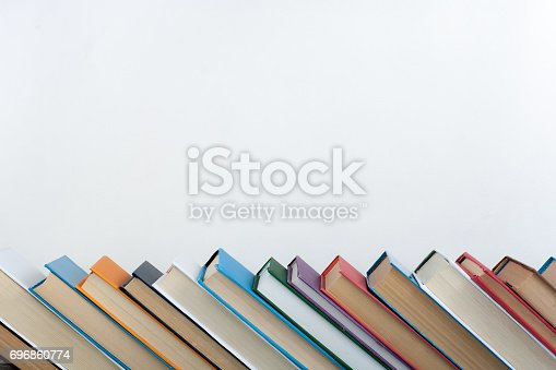 690358116 istock photo Stack of colorful books. Education background. Back to school. Book, hardback colorful books on wooden table. Education business concept. Copy space for text 696860774