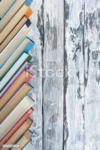 istock Stack of colorful books. Education background. Back to school. Book, hardback colorful books on wooden table. Education business concept. Copy space for text 696860808