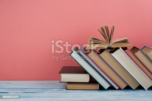 690358116 istock photo Stack of colorful books. Education background. Back to school. Book, hardback colorful books on wooden table. Education business concept. Copy space for text 696860832