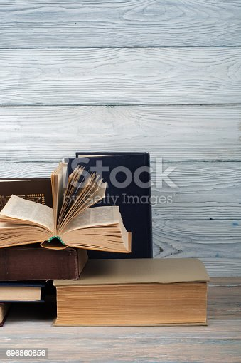 690358116 istock photo Stack of colorful books. Education background. Back to school. Book, hardback colorful books on wooden table. Education business concept. Copy space for text 696860856
