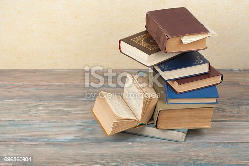 istock Stack of colorful books. Education background. Back to school. Book, hardback colorful books on wooden table. Education business concept. Copy space for text 696860904