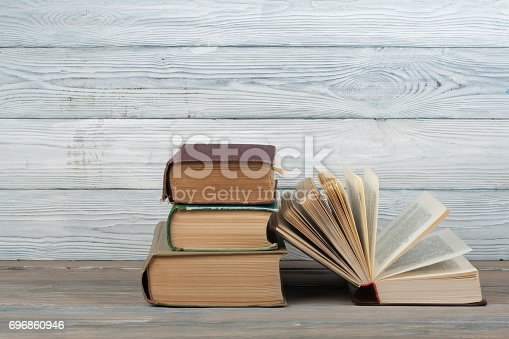 690358116 istock photo Stack of colorful books. Education background. Back to school. Book, hardback colorful books on wooden table. Education business concept. Copy space for text 696860946
