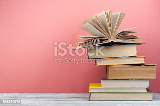 690358116 istock photo Stack of colorful books. Education background. Back to school. Book, hardback colorful books on wooden table. Education business concept. Copy space for text 696860978