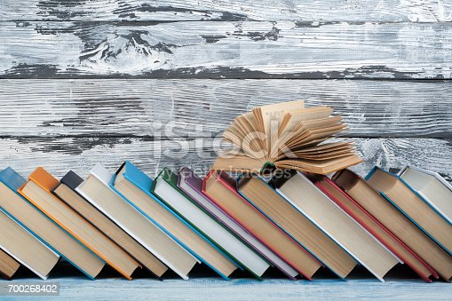 istock Stack of colorful books. Education background. Back to school. Book, hardback colorful books on wooden table. Education business concept. Copy space for text 700268402
