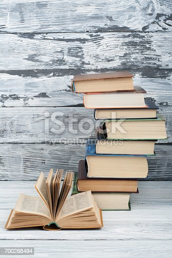 696860774 istock photo Stack of colorful books. Education background. Back to school. Book, hardback colorful books on wooden table. Education business concept. Copy space for text 700268494