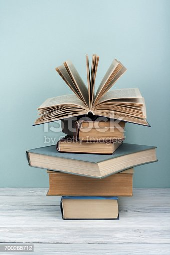 istock Stack of colorful books. Education background. Back to school. Book, hardback colorful books on wooden table. Education business concept. Copy space for text 700268712