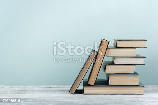 istock Stack of colorful books. Education background. Back to school. Book, hardback colorful books on wooden table. Education business concept. Copy space for text 700268816