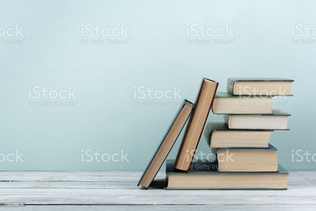 Stack of colorful books. Education background. Back to school. Book, hardback colorful books on wooden table. Education business concept. Copy space for text stock photo