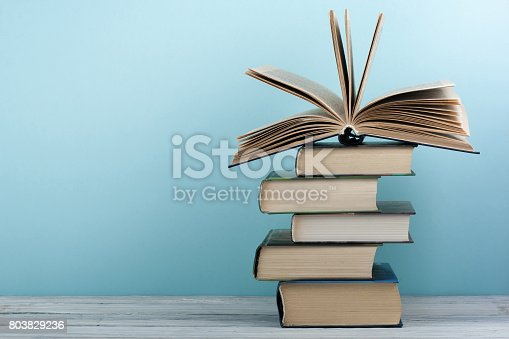 istock Stack of colorful books. Education background. Back to school. Book, hardback colorful books on wooden table. Education business concept. Copy space for text 803829236