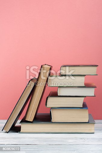 istock Stack of colorful books. Education background. Back to school. Book, hardback colorful books on wooden table. Education business concept. Copy space for text 803829272