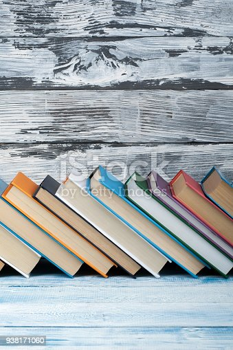 690358116 istock photo Stack of colorful books. Education background. Back to school. Book, hardback colorful books on wooden table. Education business concept. Copy space for text 938171060