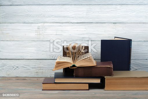 690358116 istock photo Stack of colorful books. Education background. Back to school. Book, hardback colorful books on wooden table. Education business concept. Copy space for text 943656920