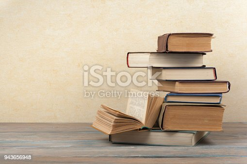 istock Stack of colorful books. Education background. Back to school. Book, hardback colorful books on wooden table. Education business concept. Copy space for text 943656948