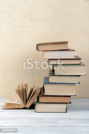 690358116 istock photo Stack of colorful books. Education background. Back to school. Book, hardback colorful books on wooden table. Education business concept. Copy space for text 943656972