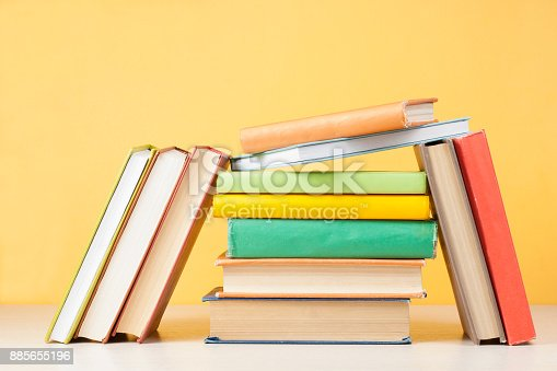897558204 istock photo Stack of colorful books. Education background. Back to school. Copy space for text. 885655196