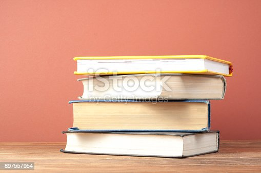istock Stack of colorful books. Education background. Back to school. Copy space for text. 897557954