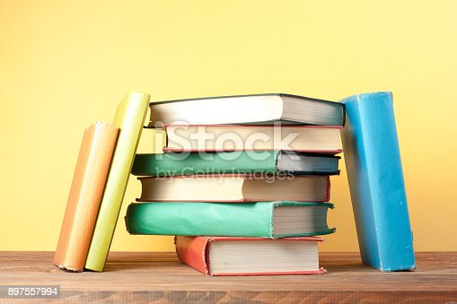 istock Stack of colorful books. Education background. Back to school. Copy space for text. 897557994