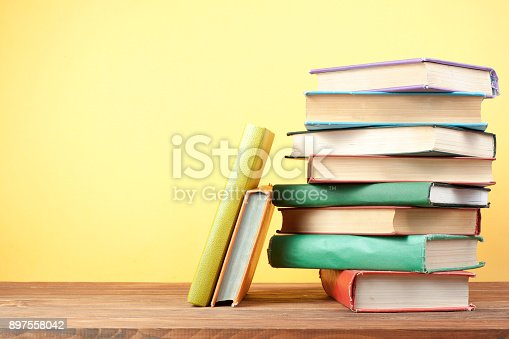897558204 istock photo Stack of colorful books. Education background. Back to school. Copy space for text. 897558042