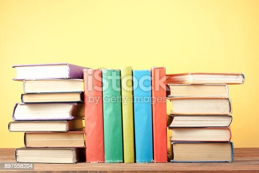 istock Stack of colorful books. Education background. Back to school. Copy space for text. 897558204